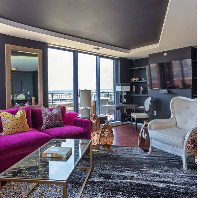Fuchsia velvet sofa and black and white interior